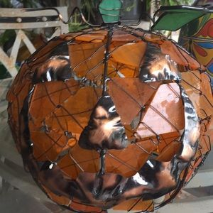 Cut glass and wire pumpkin.